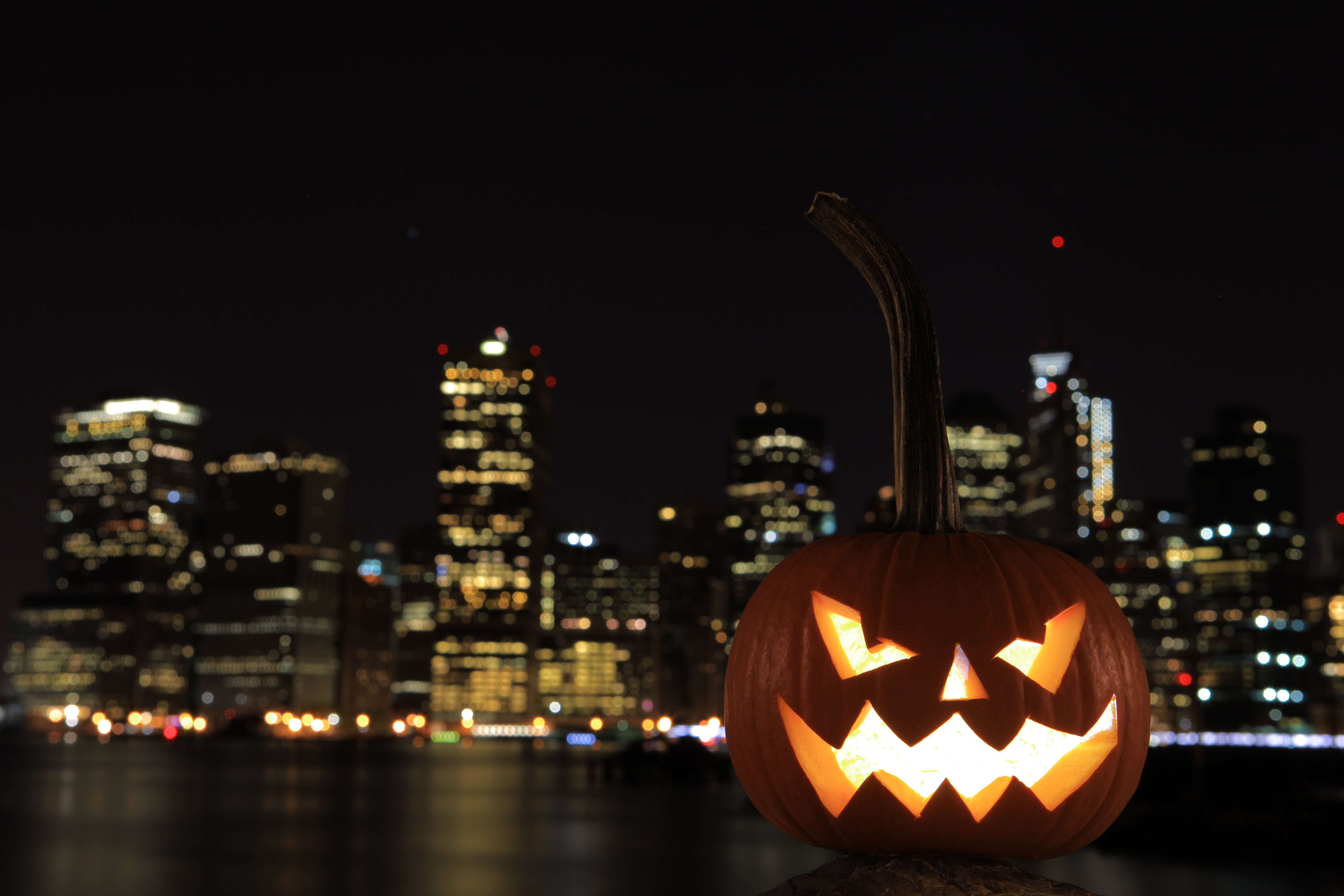 New York City Night Skline in the bacground of a Halloween Pumpkin